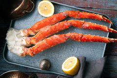 Fresh crab claws on vintage wooden background Royalty Free Stock Images