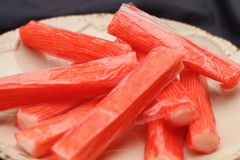 Fresh crab stick on clean plate. Stock Photos