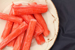 Fresh crab stick on clean plate. Royalty Free Stock Photos
