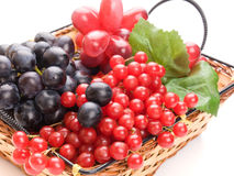 Fresh cranberries and grapes in basket Stock Photo