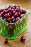 Fresh cranberries in a green glass bowl. Fresh ripe Cape Cod cranberry fruit in a vintage depression glass bowl Stock Photography