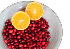 Fresh cranberries and orange Royalty Free Stock Images