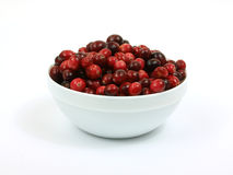 Fresh cranberries in white bowl Royalty Free Stock Photos