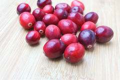 Fresh Cranberries on wood background. (light wood color Royalty Free Stock Photo