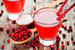 Fresh cranberry drink on wooden background. Red bilberry, whortl Stock Photography