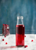 Fresh cranberry fruit drink in bottle Stock Image