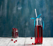 Fresh cranberry fruit drink in bottle Royalty Free Stock Photos