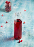 Fresh cranberry fruit drink in bottle Stock Images