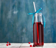 Fresh cranberry fruit drink in bottle Stock Photo