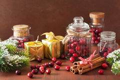 Fresh cranberry in glass jars, winter decoration and gifts Royalty Free Stock Photos