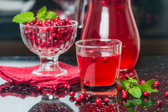 Fresh cranberry juice with mint. On black background Stock Photography