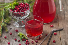 Fresh cranberry juice with mint. On wooden background Stock Image