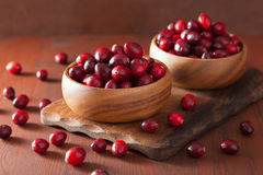 Fresh cranberry in wooden bowls over rustic table Stock Photo