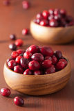 Fresh cranberry in wooden bowls over rustic table Royalty Free Stock Image