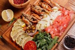 Fresh crayfish, red and white pangasius fish fillet Royalty Free Stock Photo