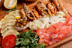 Fresh crayfish, red and white pangasius fish fillet Royalty Free Stock Photography
