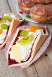 Fresh cream-coloured Eclair cookie Royalty Free Stock Photography