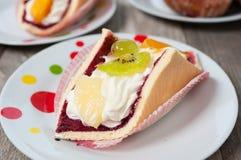 Fresh cream-coloured Eclair cookie Stock Photo