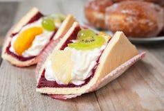 Fresh cream-coloured Eclair cookie Royalty Free Stock Photos