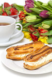 Fresh cream puff, strawberry and cup of tea Royalty Free Stock Images