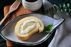 Fresh Cream Roll Cake with Hot Tea. Top view of fresh cream roll cake with hot tea pn wooden board stock image