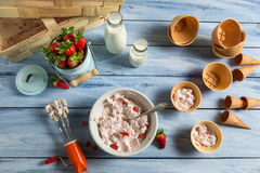 Fresh cream and strawberries as ingredients for ice cream. On old wooden table Royalty Free Stock Photo