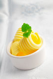 Fresh creamy rolled butter Royalty Free Stock Photos