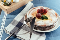 Fresh Creamy traditional cheesecake with grapes and sprinkled wi Royalty Free Stock Photo