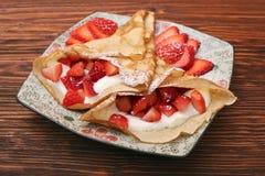 Fresh crepes with strawberries and yogurt Stock Photo