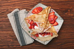 Fresh crepes with strawberries and yogurt Royalty Free Stock Images