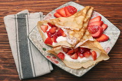 Fresh crepes with strawberries and yogurt Royalty Free Stock Photography