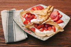 Fresh crepes with strawberries and yogurt Stock Photography