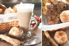 Fresh, crispy buns and croissants in a wicker basket and frothy. Cappuccino Royalty Free Stock Image
