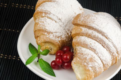Fresh crispy croissants with sprinkles on plate mint Stock Photos