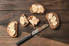 Fresh crispy toasts with chocolate paste and bananas Stock Photos