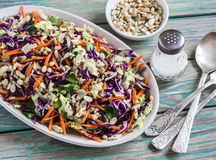 Fresh crispy vegetable salad with red cabbage, carrots, sweet peppers, herbs and seeds. Healthy food Stock Images