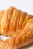 Fresh croissant. With caramelized white background Stock Photography