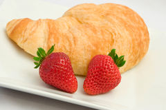 Fresh croissant. Freshly baked croissant with strawberries Royalty Free Stock Photo