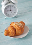 Fresh croissant with almond shavings Royalty Free Stock Photo