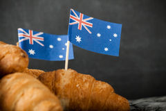 Fresh croissant and australian flag. On dark background Stock Photography