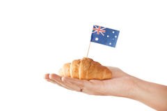 Fresh croissant and australian flag. Isolated on white background Royalty Free Stock Photography
