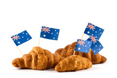 Fresh croissant and australian flag. Isolated on white background Stock Images