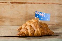 Fresh croissant and australian flag Royalty Free Stock Photos
