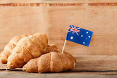 Fresh croissant and australian flag on wood desk. Greeting card Stock Images