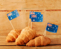 Fresh croissant and australian flag on wood desk. Greeting card Stock Photography