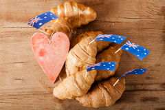 Fresh croissant and australian flag on wood desk. Greeting card Royalty Free Stock Photography