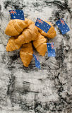 Fresh croissant and australian flag. On wood desk. Greeting card Royalty Free Stock Images