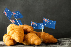 Fresh croissant and australian flag. On wood desk. Greeting card Stock Image
