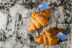 Fresh croissant and australian flag. On wood desk. Greeting card Royalty Free Stock Photo