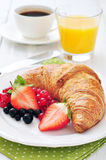 Fresh croissant with berries Stock Image